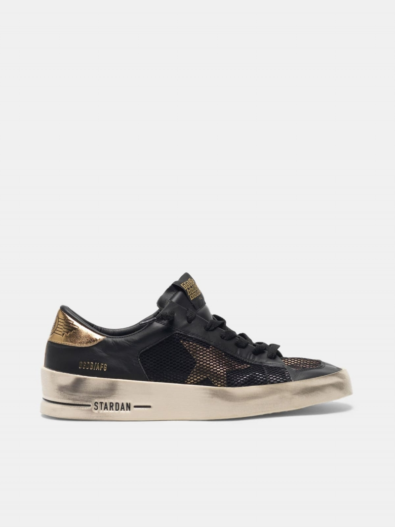 Stardan sneakers in black and gold leather with mesh inserts