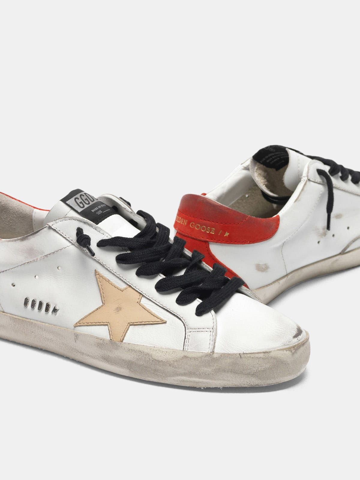 White Super-Star sneakers with red rear and black laces