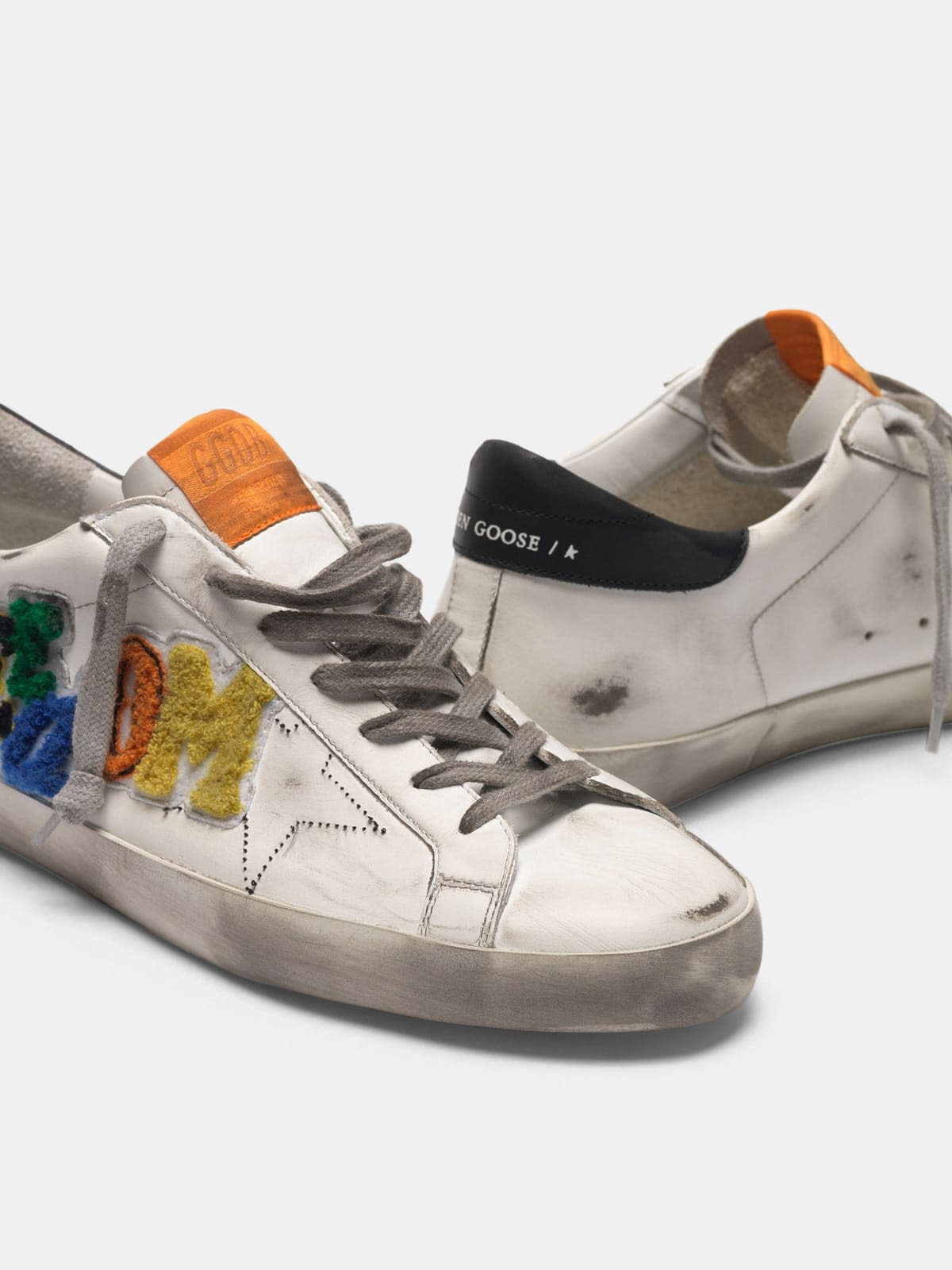 White Superstar sneakers with multicoloured patch