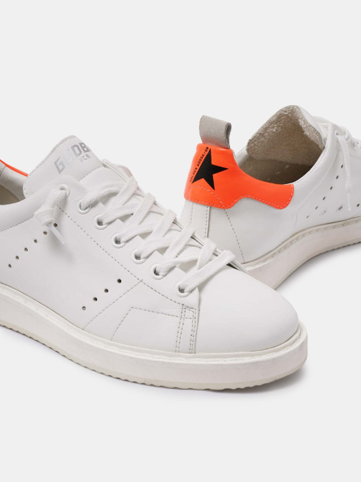 White Starter sneakers with fluorescent orange heel tab