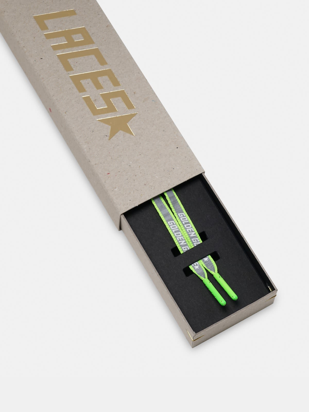 Women's neon green reflective laces with logo