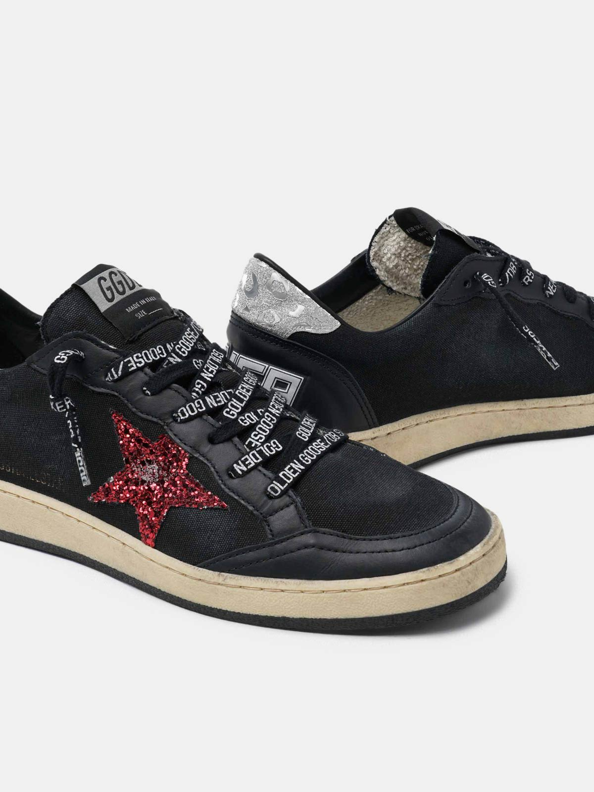Black Ball Star sneakers with glittery purple star
