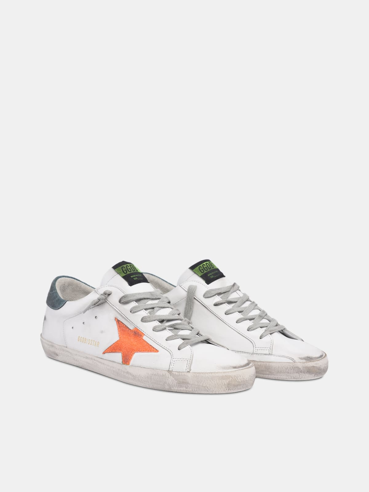 White Super-Star sneakers with orange star